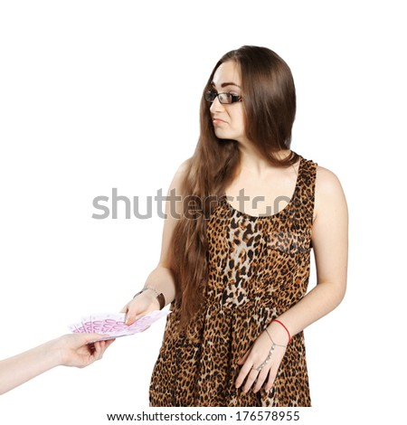 Long-haired teenager girl in leopard dress accepts a bribe in euro, isolated on white background - stock photo