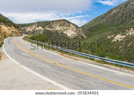 Long highway road bends through the Angeles National Forest above LA, California. - stock photo