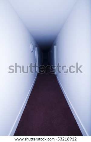 Long hotel corridor with red carpet - stock photo