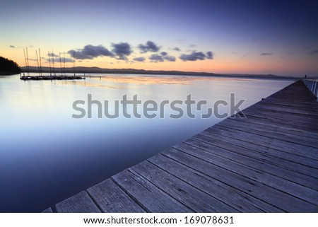 Long Jetty and Tuggerah Lakes after sunset at dusk.  Long Exposure - stock photo