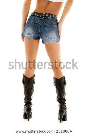 long legs in cowboy boots and denim shorts over white - stock photo