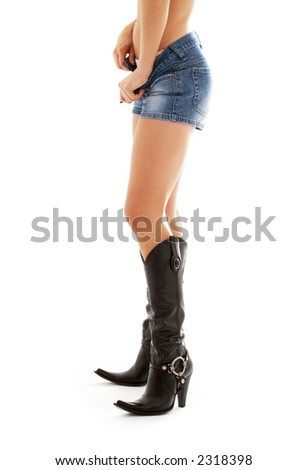 long legs in cowboy boots over white - stock photo
