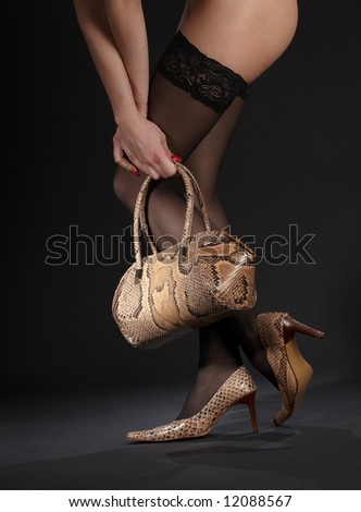 long legs in snakeskin shoes with handbag over black