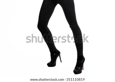 Long legs in tight pants - stock photo