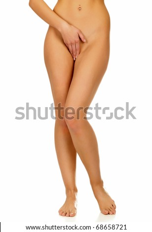 Long legs of pretty tanned woman, isolated on white background. - stock photo
