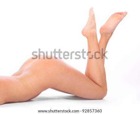 Long legs of relaxed slim woman. - stock photo