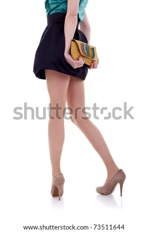 long legs on high heels and purse over white - stock photo