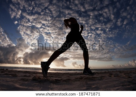 Long Legs Running on the Beach - stock photo