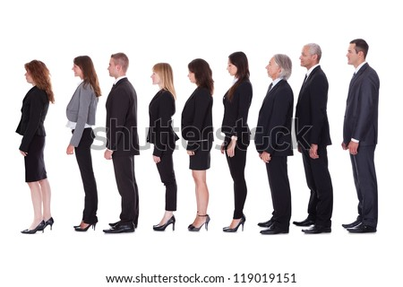 Long line of diverse professional business people standing in a queue in profile isolated on white