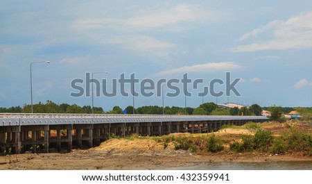Long modern bridge against blue sky background