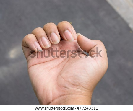 Long nails on human hand.