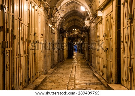 long narrow street in the Old City of Jerusalem - stock photo
