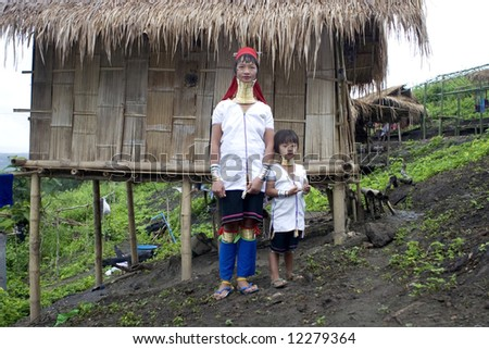 Long necked woman with child, Asia - stock photo
