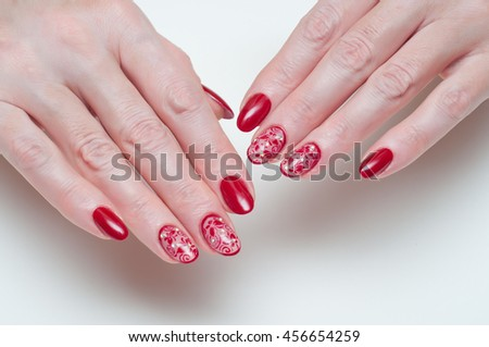 long oval nails with maroon mesh butterfly and crystals