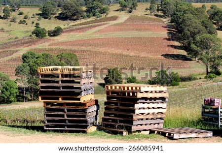Long photo of pallets sitting outside overlooking the hillside of a vineyard in Sydney Australia on the countryside - stock photo