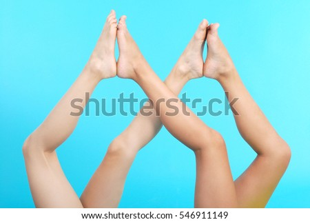 Long pretty woman legs, isolated on blue