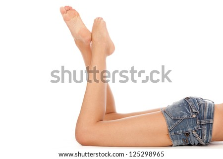 Long pretty woman legs, isolated on white. - stock photo