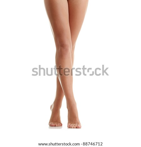 Long pretty woman legs isolated on white - stock photo