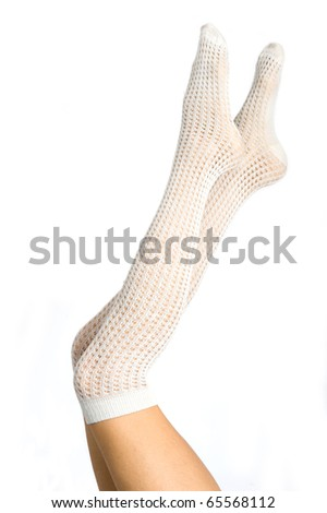 Long pretty woman legs wearing fishnet stockings isolated on white.