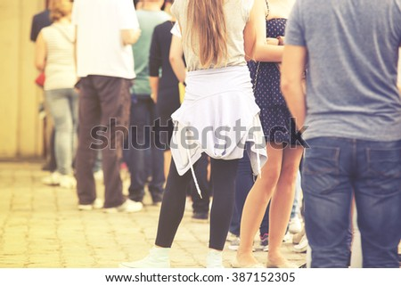 Long queue of people, vintage effect - stock photo