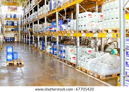 Long rack in warehouse with chemical liquids - stock photo