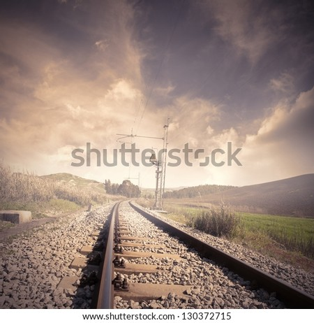 Long railroad at the sunrise - stock photo