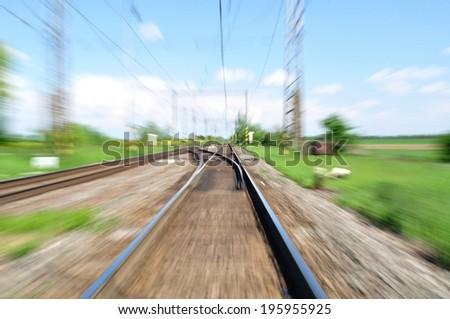 Long railway tracks. Blurred with zoom - stock photo
