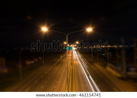 long road at dark night motion blurred side.