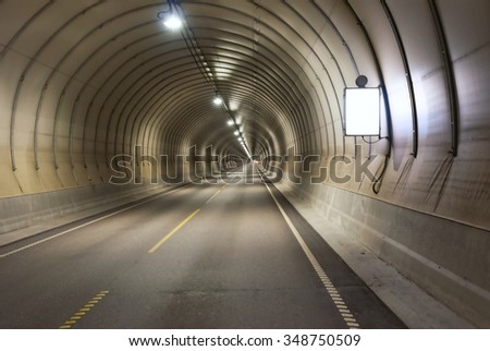 Long road tunnel - stock photo