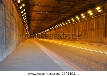 Long road tunnel in London, United Kingdom - stock photo