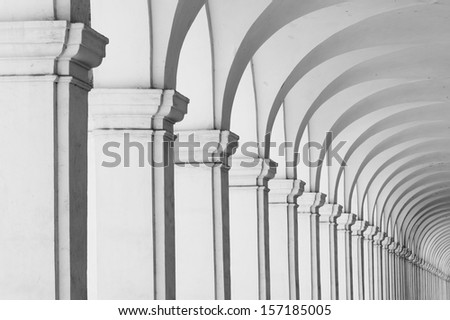 Long row of colonnade columns and arcs - stock photo