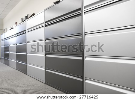 Long row of large filing cabinets in an office or hospital - stock photo