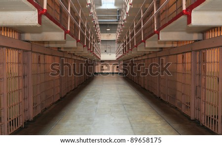 Long row of prison cells - stock photo