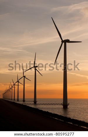 Long row of windturbines in the sea - stock photo