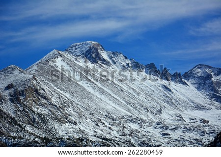 long's peak as seen from snowshoeing on  the emerald lake trail in   rocky mountain national park, colorado         - stock photo