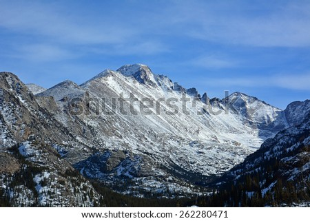 long's peak as seen from the emerald  lake trail while snowshoeing in  rocky mountain national park, colorado         - stock photo