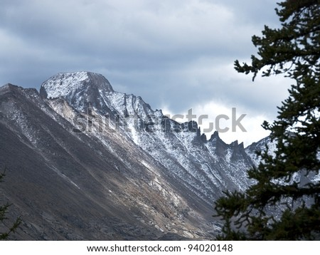 Long's Peak in Rocky Mountain National Park, under brewing storm clouds - stock photo