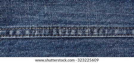 Long seam on the jeans texture close-up - stock photo