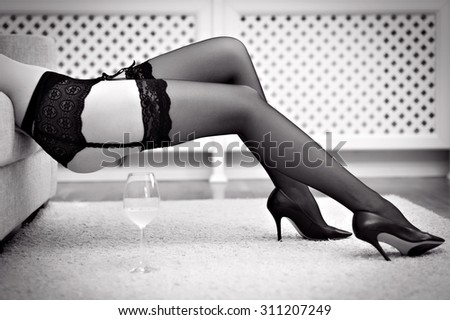Long sexy woman legs in stockings. Black and white. - stock photo