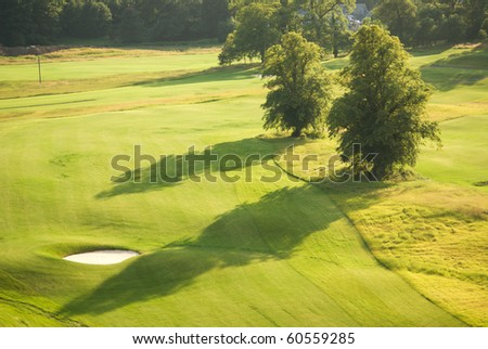 Long shadows in evening on golf course in Scotland - stock photo