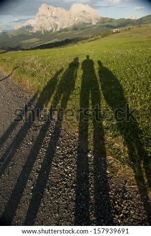 Long shadows on the Alpe di Siusi, Dolomite, Italy - stock photo