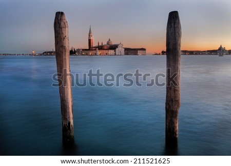 Long shot exposure of San Giorgio Maggiore church viewed from St. Marco Square at sunrise time in Venice Italy - stock photo