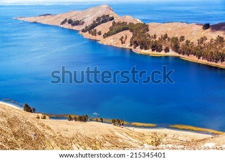 Long skinny peninsula on Isla del Sol on the Bolivian side of Lake Titicaca - stock photo