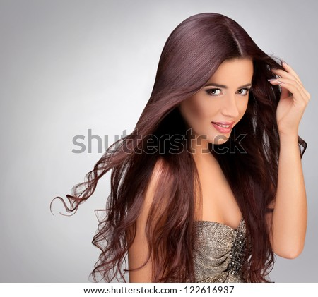 Long Smooth Hair. Portrait of Beautiful Brunette Woman . Good quality retouching.