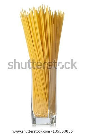 Long spaghetti in a glass on white background. - stock photo