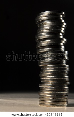 long stack of silver coins - stock photo