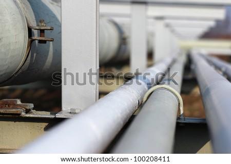 long steel pipe in oil refinery - stock photo