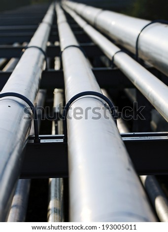 long steel pipe in oil refinery station - stock photo