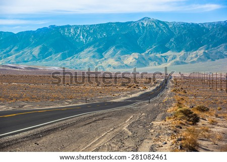 Long straight highway in the foothills of Sierra Nevada mountains - stock photo