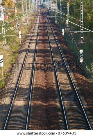 Long straight railroad track - stock photo